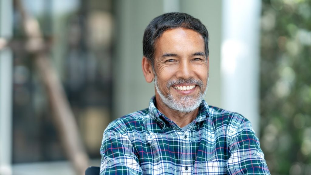 Portrait of happy mature man with white, grey stylish short beard looking at camera outdoor. Casual lifestyle of retired hispanic people or adult asian man smile with confident at coffee shop cafe. concept: business trends