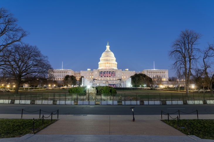 Washington DC, USA - January 12th 2021 -The West of the US Capitol Building prepared for the 59th presidential inauguration ceremony. The platform has been created and the five flags are hung. President Joe Biden's American Rescue Plan