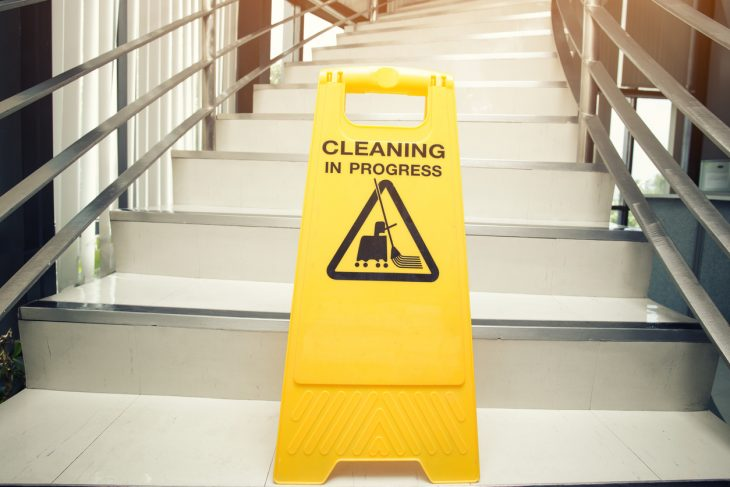 cleaning progress caution sign in office. concepr