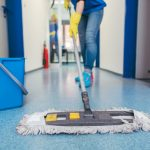 Close-up of cleaners moping the floor of a hall. concept: Commercial Cleaning