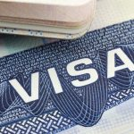 The American Visa in a passport page (USA) background. concept: DV lottery