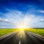 Road towards sunset representing a better future and Lessons Learned from COVID-19