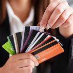 Woman holding colorful easy approval credit cards